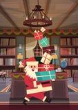 Bandera del concepto de los días de fiesta de Santa Holding Present Stack Winter de la Feliz Navidad y de la tarjeta de felicitac Foto de archivo libre de regalías