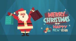 Bandera del concepto de los días de fiesta de Santa Holding Shooping Bags Winter de la Feliz Navidad y de la tarjeta de felicitac Imagen de archivo