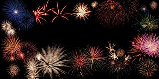 Bandera del día de fiesta con los fuegos artificiales Imagen de archivo