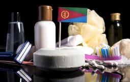 Bandera del Eritrean en el jabón con todos los productos para la gente Fotos de archivo
