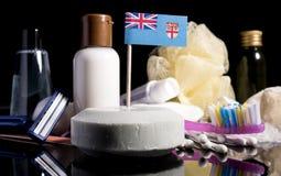 Bandera del Fijian en el jabón con todos los productos para la gente Fotografía de archivo