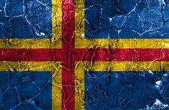 Bandera del grunge de Aland, bandera dependiente del territorio de Finlandia fotografía de archivo libre de regalías