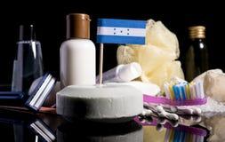 Bandera del Honduran en el jabón con todos los productos para la gente Fotografía de archivo