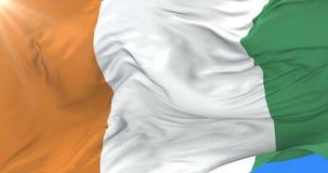 Bandera del ` Ivoire de Costa de Marfil o de CÃ'te d que agita en el viento en lento, lazo ilustración del vector