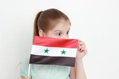 Bandera del niño y de Siria Imagenes de archivo
