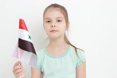 Bandera del niño y de Siria Fotografía de archivo