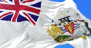 Bandera del territorio antártico británico que agita en el viento en lento, lazo