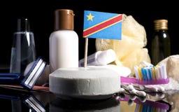 Bandera Democratic del República del Congo en el jabón con todos los productos para la gente Imagen de archivo libre de regalías