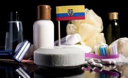 Bandera ecuatoriana en el jabón con todos los productos para la gente Imagen de archivo