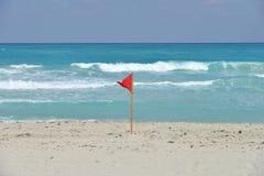 Bandera en la playa Imagenes de archivo