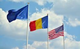 Bandera europea de la unión, rumana y americana Imagen de archivo libre de regalías