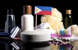 Bandera filipina en el jabón con todos los productos para la gente Imágenes de archivo libres de regalías