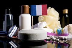 Bandera francesa en el jabón con todos los productos para la gente Imagen de archivo libre de regalías