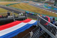Bandera francesa sobre la pista Imagen de archivo libre de regalías