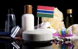 Bandera gambiana en el jabón con todos los productos para la gente Imágenes de archivo libres de regalías