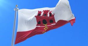 Bandera gibraltareña que agita en el viento con el cielo azul, lazo stock de ilustración
