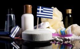 Bandera griega en el jabón con todos los productos para la gente Imágenes de archivo libres de regalías