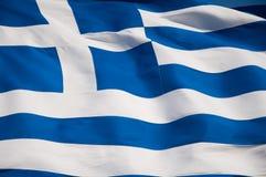 Bandera griega en la acrópolis de Atenas, Grecia. imagen de archivo libre de regalías