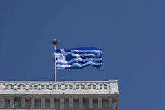 Bandera griega que agita en el viento Imágenes de archivo libres de regalías