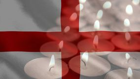 Bandera inglesa con las velas que son sopladas hacia fuera en el fondo