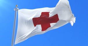 Bandera internacional de la Cruz Roja que agita en el viento en lento con el cielo azul, lazo