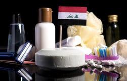 Bandera iraquí en el jabón con todos los productos para la gente Fotografía de archivo libre de regalías