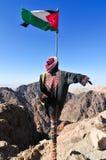 Bandera jordana en el Petra, Jordania Foto de archivo libre de regalías