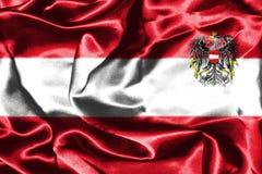 Bandera nacional austríaca con el escudo de armas Imagenes de archivo
