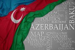 Bandera nacional colorida que agita de Azerbaijan en un fondo gris con palabras importantes sobre país foto de archivo libre de regalías