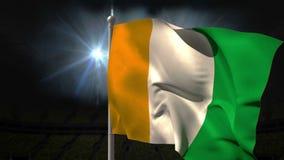 Bandera nacional de Costa de Marfil que agita en asta de bandera ilustración del vector
