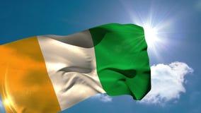Bandera nacional de Costa de Marfil que sopla en la brisa ilustración del vector