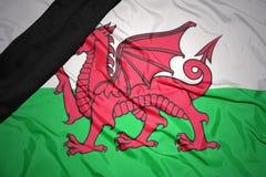 bandera nacional de País de Gales con la cinta de luto negra Fotografía de archivo libre de regalías