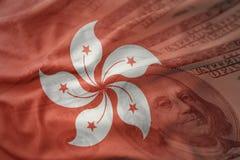 Bandera nacional que agita colorida de Hong-Kong en un fondo americano del dinero del dólar Foto de archivo libre de regalías