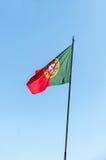 Bandera portuguesa que agita Fotografía de archivo libre de regalías