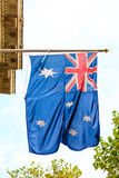 Bandera que agita australiana al aire libre Foto de archivo
