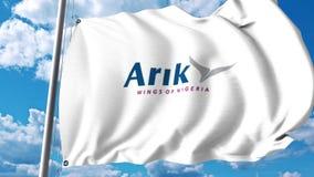 Bandera que agita con el logotipo de Arik Air representación 3d Imágenes de archivo libres de regalías