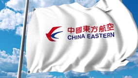 Bandera que agita con el logotipo de China Eastern Airlines representación 3d stock de ilustración