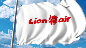 Bandera que agita con el logotipo de Lion Air representación 3d Foto de archivo