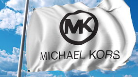 Bandera que agita con el logotipo de Michael Kors Representación de Editoial 3D Fotografía de archivo