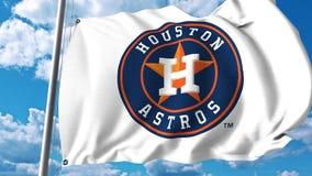 Bandera que agita con el logotipo profesional del equipo de Houston Astros Representación editorial 3D Fotos de archivo libres de regalías