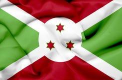 Bandera que agita de Burundi ilustración del vector