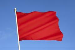 Bandera roja del peligro fotografía de archivo