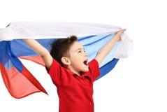 Bandera rusa nacional del control del patriota del muchacho del deporte de la fan que celebra el espacio de risa sonriente feliz  Fotos de archivo