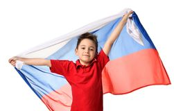 Bandera rusa nacional del control del patriota del muchacho del deporte de la fan que celebra el espacio de risa sonriente feliz  Foto de archivo libre de regalías