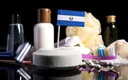 Bandera salvadoreña del EL en el jabón con todos los productos para la gente Imagen de archivo libre de regalías
