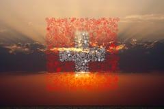 Bandera suiza de los fuegos artificiales en puesta del sol Imágenes de archivo libres de regalías