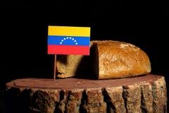 Bandera venezolana en un tocón con pan imagen de archivo