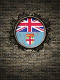 Bandera vieja de Fiji en pared de ladrillo Imagenes de archivo