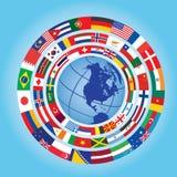 Banderas alrededor del globo Fotos de archivo