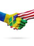 Banderas apretón de manos de los países de San Vicente y las Granadinas, Estados Unidos Foto de archivo